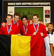 Loughborough, England - Saturday 31 July 2010: Mens team overall winners Belgium, comprising Willem Tack, Wouter Tack, Jonas Vermuelen and Stijn Geiregat get their gold medals during the World Rope Skipping Championships held at Loughborough University, England. The championships run over 7 days and comprise junior categories for 12-14 year olds in the World Youth Tournament, 15-17 year olds male and female championships, and any age open championships. In the team competitions, 6 events are judged, the Single Rope Speed, Double Dutch Speed Relay, Single Rope Pair Freestyle, Single Rope Team Freestyle, Double Dutch Single Freestyle and Double Dutch Pair Freestyle.  The mens overall winners were Belgium, and the open mixed overall single rope winners were Australia. For more information check www.rs2010.org. Picture by Andrew Tobin/Picture It Now.