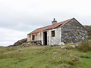 An abandoned house in Loch Siogport on the Isle of South Uist, Outer Hebrides, Scotland on 23 July 2018