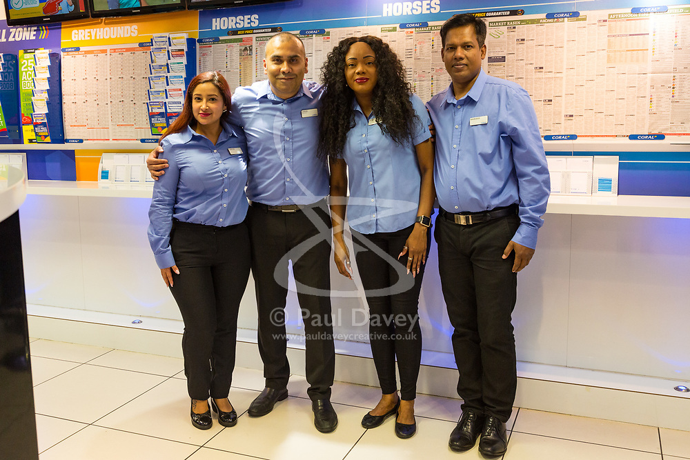 Betting Shop Manager-of-the-Year finalist Amran Al-Haque poses with team members, Vanessa Lopez, left, Elaine Norbert,  Mahbubur Rahman at Coral, 1 Canada Square, Canary Wharf, London, November 08 2018.