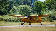 Stinson Voyager taking off at Wings and Wheels.