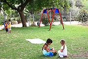 Israel, moshav Sde Yitzhak. Children play in the playground at the settlement