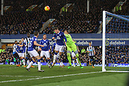 Ross Barkley of Everton (20) gets his head to the ball and clears the danger. Barclays Premier League match, Everton v Newcastle United at Goodison Park in Liverpool on Wednesday 3rd February 2016.<br /> pic by Chris Stading, Andrew Orchard sports photography.