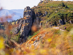 Rear view of women hiking up over rocky mountain of Vosges at Gazon du Faing, France