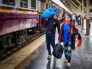 02 JANUARY 2019 - BANGKOK, THAILAND:      People in Hua Lamphong Train Station in Bangkok rush to get to a train going to Trang, in southern Thailand. The train and bus stations in Bangkok were crowded Wednesday with people going home after the long New Year's weekend.     PHOTO BY JACK KURTZ