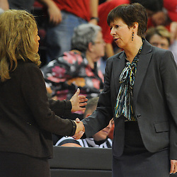 Rutgers Scarlet Knights head coach C. Vivian Stringer (left) and Notre Dame Fighting Irish head coach Muffet McGraw shake hands following  NCAA Big East women's basketball action between Notre Dame and Rutgers at the Louis Brown Athletic Center. Notre Dame defeated Rutgers 71-41.