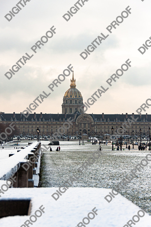 View of the Hôtel des Invalides in with snow on a winter day. Paris France.