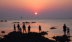 May 3, 2019 - Yantai, China - Tourists watch the sunrise at a beach in Yantai, east China's Shandong Province. People across China take advantage of the four-day Labor Day national holiday to get relaxed in recreational activities. (Credit Image: © Xinhua via ZUMA Wire)