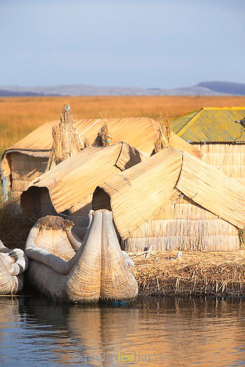 Reed house and boat, Lake Titicaka, Puno, Peru, South America