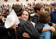 PRICE CHAMBERS / NEWS&GUIDE<br /> Jackson Hole High School graduates Emily Overton and Bridger Kessler embrace after the commencement ceremony Saturday in the school gym.