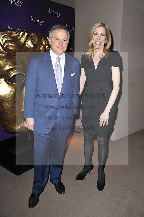 JOHN & DARCY RIGAS at the BAFTA Nominees party 2011 held at Asprey, 167 New Bond Street, London on 12th February 2011.