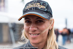 Sandra Mingrone of Brazil (now living in Miami) at the Harley-Davidson display at Daytona International Speedway on the first day of Daytona Beach Bike Week 2015. FL, USA. Saturday, March 7, 2015.  Photography ©2015 Michael Lichter.