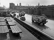 23/08/1958<br /> 08/23/1958<br /> 23 August 1958<br /> Guinness transport on the wharf outside St James's Gate Brewery, Dublin. Image shows the fleet of Vulcan fallback trucks. Note railway trailers on left.