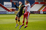 Tom Beadling of Barrowand Arthur Read of Stevenage both go to header the ball during the EFL Sky Bet League 2 match between Stevenage and Barrow at the Lamex Stadium, Stevenage, England on 27 March 2021.