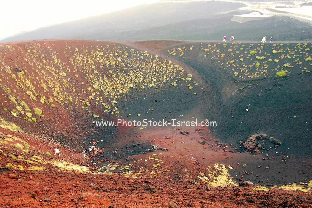 people walking around the Silvestri Crater at an altitude of 1986 meter above sea level on the Southern slopes of Mount Etna, The highest and most active volcano in Europe, Nicolosi, Sicily, Italy July 2006