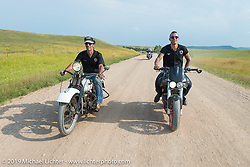 American Motordrome Wall of Death riders Dallas Dan and Cyclone Jake Wheeler takes the back roads north of Sturgis to the Broken Spoke County Line during the Sturgis Black Hills Motorcycle Rally. SD, USA. August 4, 2014.  Photography ©2014 Michael Lichter.