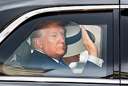 © Licensed to London News Pictures. 03/06/2019. London, UK. US President Donald Trump waves as he leaves Westminster Abbey with First Lady Melania Trump during his State Visit to the United Kingdom. During his three days in the UK he will meet with members of the Royal family and outgoing Prime Minister Theresa May before attending 75th Anniversary of D-Day commemorations in Portsmouth and France. Photo credit: Peter Macdiarmid/LNP
