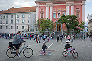 Young cyclists in Presernov Square in the Slovenian capital, Ljubljana, on 25th June 2018, in Ljubljana, Slovenia. Ljubljana is a small city with flat terrain and a good cycling infrastructure. It was featured at eighth on the Copenhagenize index listing the most bike-friendly cities in the world.