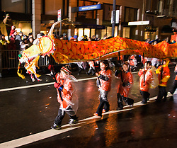 California, San Francisco: Dragons parading rain or shine in the annual Chinese New Year Parade..Photo #: 29-casanf77713.Photo © Lee Foster 2008