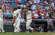 Brian Dozier #2 of the Minnesota Twins celebrates with teammate Oswaldo Arcia #31 after hitting a home run against the Chicago White Sox on June 19, 2013 at Target Field in Minneapolis, Minnesota.  The Twins defeated the White Sox 7 to 4.  Photo: Ben Krause