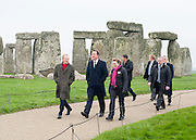 © Licensed to London News Pictures. 01/12/2014. Wiltshire, UK. Simon Thurley (red scarf) Director of English Heritage, David Cameron and Dame Helen Ghosh, Director-General of the National Trust.  British Prime Minister David Cameron visits Stonehenge today 1st December 2014. A tunnel passing Stonehenge is among dozens of new road schemes announced by the government, as part of £15bn of improvements to England's roads. Photo credit : Stephen Simpson/LNP