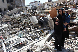 March 27, 2019 - Gaza City, Gaza Strip, Palestinian Territory - Palestinians inspect their house that demolished two days ago by an Israeli airplane, in Gaza city. Palestinian Minister of Public Works and Housing, Mufid al-Hasayneh, said that recent Israeli airstrikes on the besieged Gaza Strip left 30 residential structures completely destroyed, and at least 500 other others partially damaged  (Credit Image: © Mahmoud Ajjour/APA Images via ZUMA Wire)