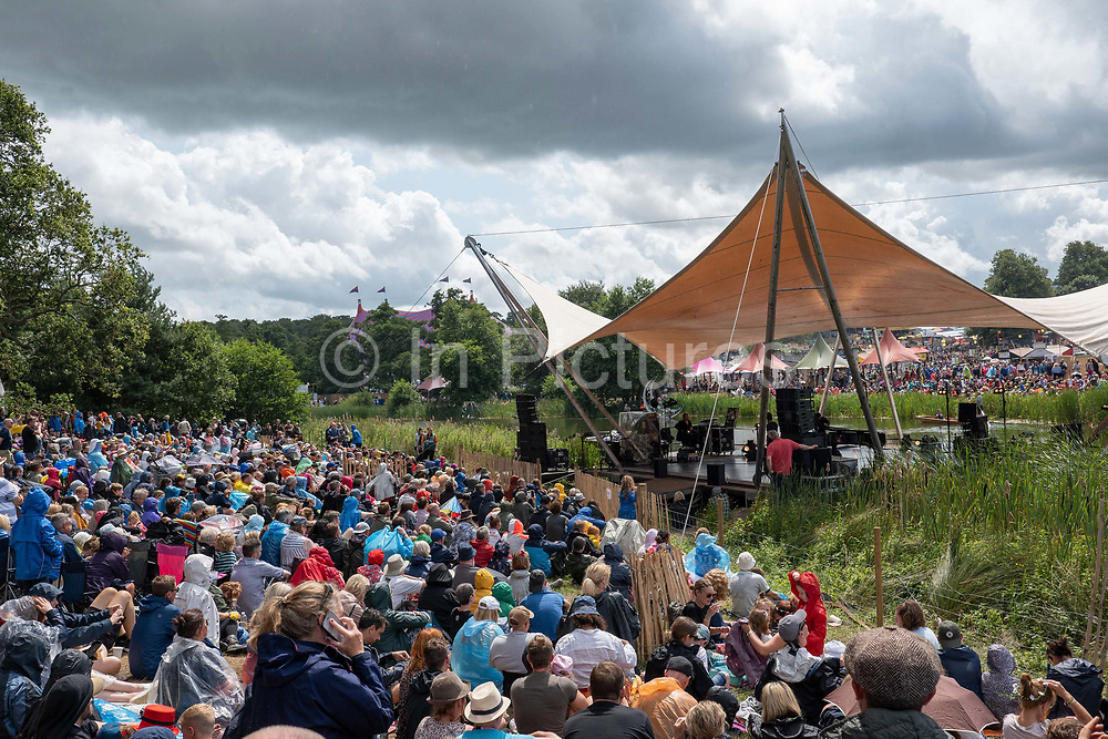 Rain during the Ben Folds and A Piano at the Dance On The Waterfront Stage during Latitude Festival on the 20th July 2019 in Southwold in the United Kingdom.
