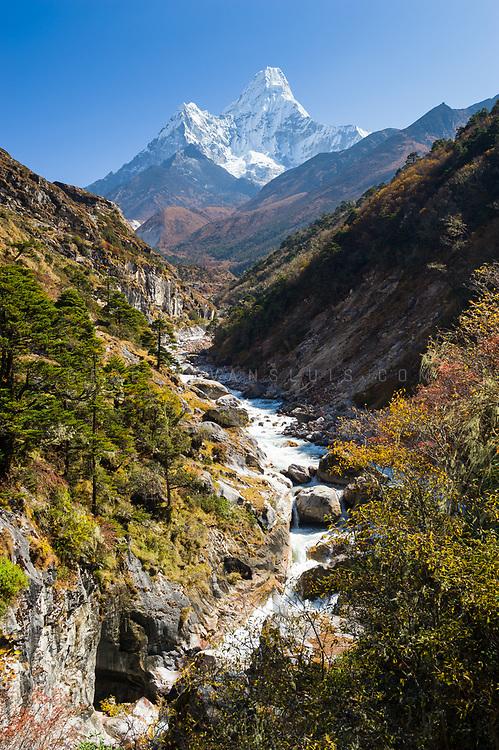 Ama Dablam (6856 m) towers over a river in the Nepal Himalaya. Photo © robertvansluis.com