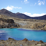 The Emerald Lake on the Tangariro Alpine Crossing.  The Tongariro Alpine Crossing is a 7-8 hour hike traversing two active volcanoes within the Tongariro National Park, North Island, New Zealand.  It is considered to be the best one day hike in New Zealand and in the top 10 one day hikes in the world. Packed into the 19.4km hike is an array of diverse landscapes and vegetations. From tussock like alpine meadows, to rugged lava flows, desert like craters and emerald lakes.  The Tongariro Alpine  9th January 2011. Photo Tim Clayton