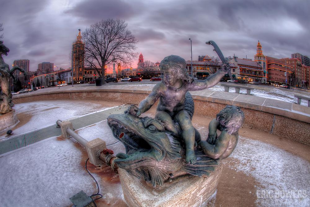 Stepping around inside the JC NIchols Fountain empty of water in winter, Mill Creek Park, Country Club Plaza, Kansas City, Missouri.
