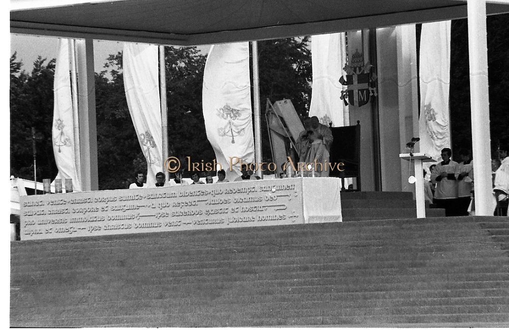 Pope John-Paul II visits Ireland..1979..29.09.1979..09.29.1979..29th September 1979..Today marked the historic arrival of Pope John-Paul II to Ireland. He is here on a three day visit to the country with a packed itinerary. He will celebrate mass today at a specially built altar in the Phoenix Park in Dublin. From Dublin he will travel to Drogheda by cavalcade. On the 30th he will host a youth rally in Galway and on the 1st Oct he will host a mass in Limerick prior to his departure from Shannon Airport to the U.S..Image of Pope John-Paul II as he preaches to the massed crowd ranged in front of him at the Phoenix Park.