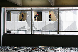 Stock photo of windows of buildings in downtown Houston blown out by winds from Hurricane Ike