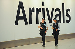 © Licensed to London News Pictures. 22/08/2012. London,UK.Armed police officers at the Heathrow airport. Athletes from all around the world are expected to arrive at the Heathrow airport for the London 2012 Paralympic Games .  Photo credit : Thomas Campean/LNP..