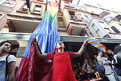 LGBT activists shout slogans and hold rainbow flags as they take part in the pride in the city's Taksim neighbourhood after Istanbul's local government announced the parade was banned. Istanbul, Turkey July 1, 2018. Photo by Depo Photos/ABACAPRESS.COM