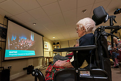 © Licensed to London News Pictures; 07/10/2021; Bristol, UK. Residents of Quarry House Care Home watch a concert by the London Symphony Orchestra with Sir Simon Rattle, live streamed from the Bath Forum to care homes across the country as a thank you and gift to care home staff and residents for their hard work and resilience during the Covid coronavirus pandemic. The concert is being staged by Bristol Beacon and the live stream broadcast is being organised thanks to sponsorship from Bristol Care Homes with a private link to watch the concert sent for free to a national database of care homes.<br /> The concert, which sees Sir Simon Rattle lead the orchestra in Martinů's Rhapsody-Concerto for viola with violist AntoineTamestit and Beethoven's Pastoral Symphony, is being performedat Bath Forum – the first time the orchestra has performed in Bath since 2008. Photo credit: Simon Chapman/LNP.