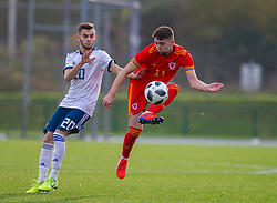 CARDIFF, WALES - Saturday, November 16, 2019: Wales' Joseph Adams (R) and Russia's Leonid Gerchikov during the UEFA Under-19 Championship Qualifying Group 5 match between Russia and Wales at the Cardiff International Sports Stadium. (Pic by Mark Hawkins/Propaganda)