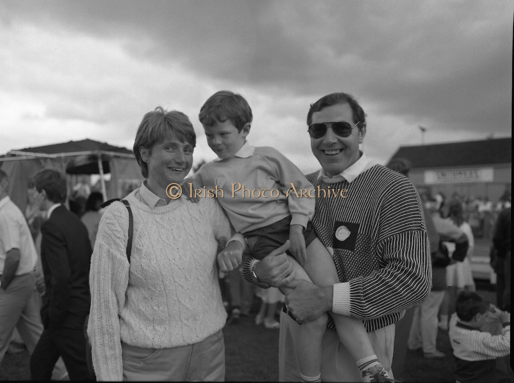 """Guinness Family Day At The Iveagh Gardens. (R83)..1988..02.07.1988..07.02.1988..2nd  July 1988..The family fun day for Guinness employees and their families took place at the Iveagh Gardens today. Top at the bill at the event were """"The Dubliners"""" who treated the crowd to a performance of all their hits. Ireland's penalty hero from Euro 88, Packie Bonner, was on hand to sign autographs for the fans...Image shows one of the families who took part in the Guinness Family day out in the Iveagh Gardens."""