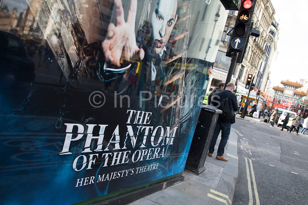 Signs advertising Phantom of the Opera West End Theatre show in London, England, United Kingdom.