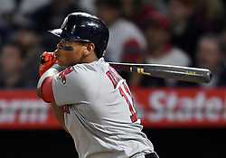 April 18, 2018 - Anaheim, CA, U.S. - ANAHEIM, CA - APRIL 18: Boston Red Sox third baseman Rafael Devers (11) hits a grand slam in the third inning of a game against the Los Angeles Angels of Anaheim played on April 18, 2018 at Angel Stadium of Anaheim in Anaheim, CA. (Photo by John Cordes/Icon Sportswire) (Credit Image: © John Cordes/Icon SMI via ZUMA Press)