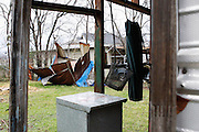 A shed used as a dog house was blown over after a small tornado passed through Billy J. Preston's, a retired World War II US Naval Amphibious Forces,  backyard at his home in Dallas, Texas, on January 29, 2013.  (Stan Olszewski/The Dallas Morning News)