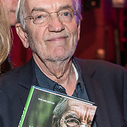 NLD/Bussum/20190306  - boekpresentatie 50 jaar Nederlandse popcultuur van Lex Harding, Lex Harding met zijn boek