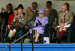 File photo dated 03/16/16 of Queen Elizabeth II, accompanied by the Duke of Edinburgh and the Prince of Wales attending the Braemar Royal Highland Gathering at the Princess Royal and Duke of Fife Memorial Park, Braemar. Balmoral in the Highlands remains one of the royals' favourite places, and held many memories for the Duke of Edinburgh. The Queen was once said to never be happier than when she was at Balmoral, Philip, too, loved the outdoor life that was synonymous with their annual break, which stretched from the end of July into October. Issue date: Friday April 4, 2021.
