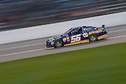 Martin Truex Jr. (56) leads the Sprint Cup NRA 500 at Texas Motor Speedway in Fort Worth on Saturday, April 13, 2013. (Cooper Neill/The Dallas Morning News)