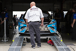 June 10, 2018 - Brooklyn, Michigan, U.S - A NASCAR official watches as the car driven by TIMMY HILL (66) goes through inspection at Michigan International Speedway. (Credit Image: © Scott Mapes via ZUMA Wire)
