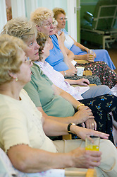 Group of women at line dancing event for Age Concern,