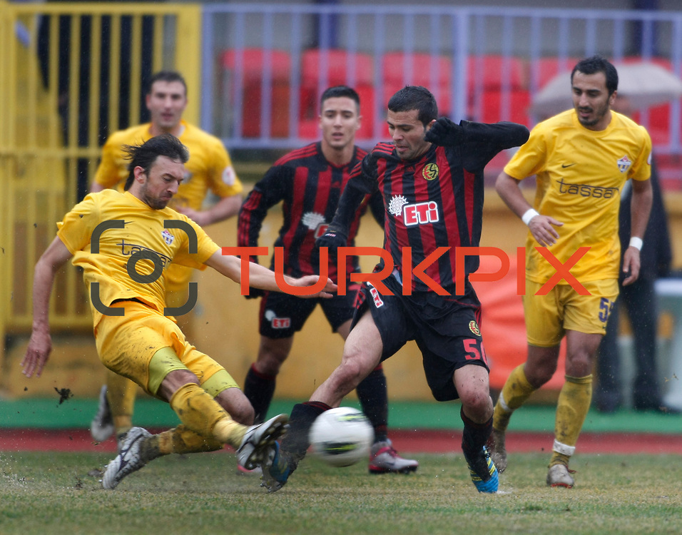 Eskisehirspor's Hurriyet Gucer (C) during their Turkey Cup matchday 3 soccer match Eyupspor between Eskisehirspor at Eyup Stadium in Istanbul Turkey on Wednesday, 11 January 2012. Photo by TURKPIX