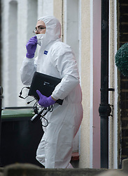 ©Licensed to London News Pictures 04/02/2020<br /> Northfleet, UK.  Police officer coming out of the property. A murder investigation has been launched by Kent police after a 44 year old man was found at a property with stab wounds in the early hours of the morning. Forensic police officers are on scene and the area in Northfleet, Kent has  police standing guard at a cordon. Photo credit: Grant Falvey/LNP