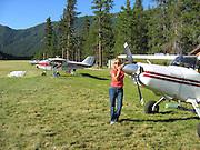 Kay Pratt posing in front of Maule M7-235C N1044L in Johnson Creek, ID