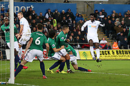 Wilfried Bony of Swansea city  ® shoots and scores his teams 1st goal to make it 1-0. Premier league match, Swansea city v West Bromwich Albion at the Liberty Stadium in Swansea, South Wales on Saturday 9th December 2017.<br /> pic by  Andrew Orchard, Andrew Orchard sports photography.