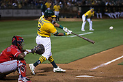 Oakland Athletics designated hitter Khris Davis (2) hits a solo home run against the Los Angeles Angels ground ball at Oakland Coliseum in Oakland, California, on September 5, 2017. (Stan Olszewski/Special to S.F. Examiner)