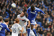 Cardiff City's Sol Bamba (14) heads wide of goal from a corner whilst being challenged by Wigan's Jake Buxton. EFL Skybet championship match, Cardiff city v Wigan Athletic at the Cardiff city stadium in Cardiff, South Wales on Saturday 29th October 2016.<br /> pic by Carl Robertson, Andrew Orchard sports photography.